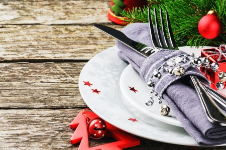 christmas fir: Christmas table setting on wooden table Stock Photo