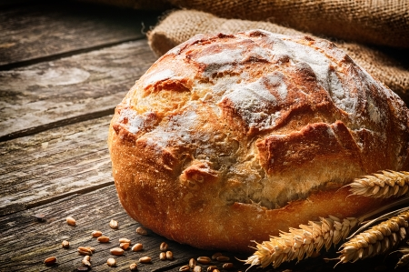 Freshly baked traditional bread on wooden table photo