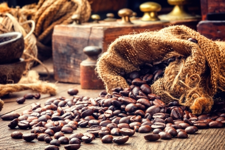 Roasted coffee beans in toned vintage setting photo