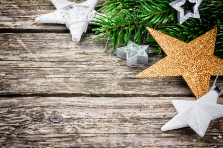 Christmas stars in festive setting on wooden background photo