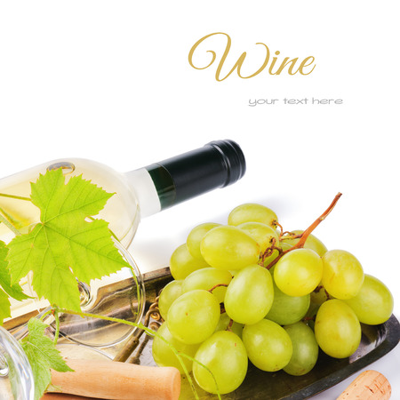 Bottle of white wine with fresh grape isolated over white
