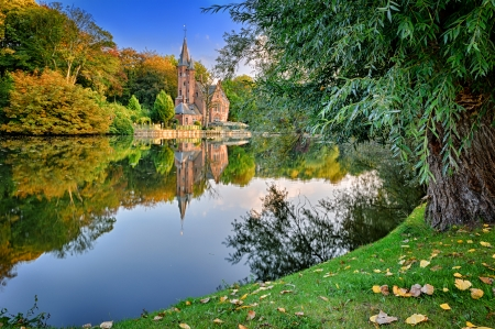 dream lake: Autumn landscape with lake and old mansion. Bruges, Belgium Stock Photo