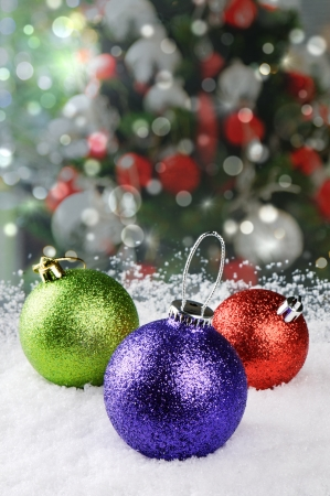 Colorful Christmas baubles on festive background photo