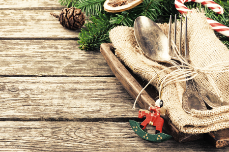 Christmas table setting in retro style on wooden table photo