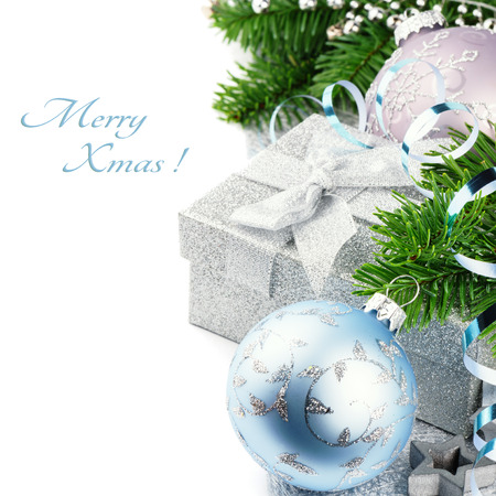 Christmas gift and festive ornaments isolated over white photo