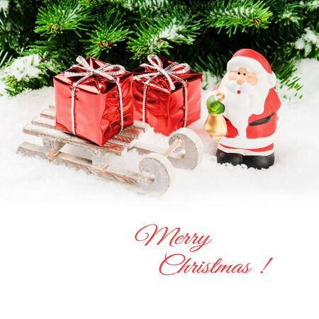 Santa Claus with Christmas gifts on wooden sledge photo