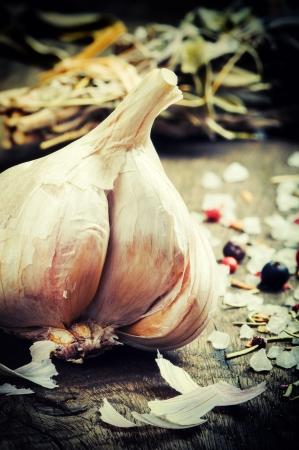 garlic clove: Fresh garlic and seasonings on wooden table Stock Photo