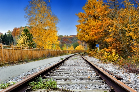 train tracks: Autumn landscape with country railway track Stock Photo