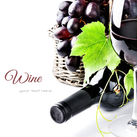 red wine bottle: Bottle of red wine with freshly harvested grape
