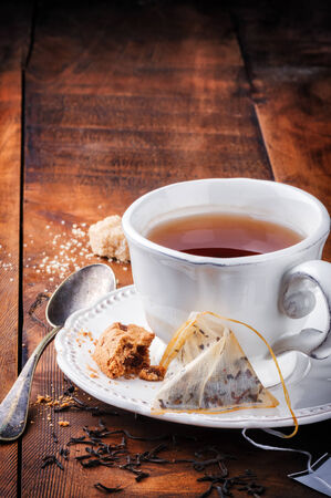 british food: Tea time. Black tea and cookie on wooden table