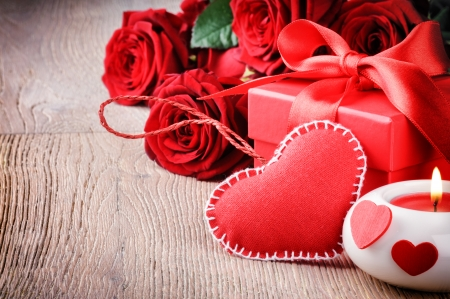 Red roses and gift box in St Valentines setting photo
