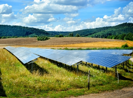 Landscape with solar energy field at sunny summer day Stock Photo