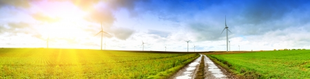 Panoramic landscape with country road and wind turbines photo