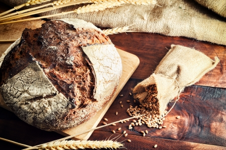 Fresh traditional bread on wooden table photo
