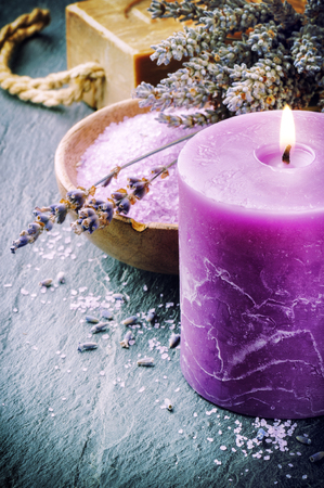 Candle, lavender flowers and bath salt photo
