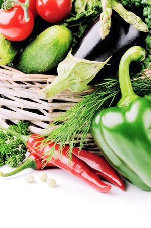 Fresh organic vegetables in wicker basket photo