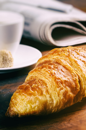 Breakfast with coffee cup and fresh croissant photo