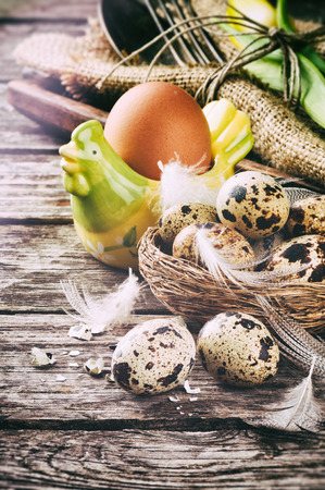 Rustic table setting with quail eggs for Easter holiday photo