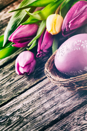 Easter setting with tulips in purple tone photo