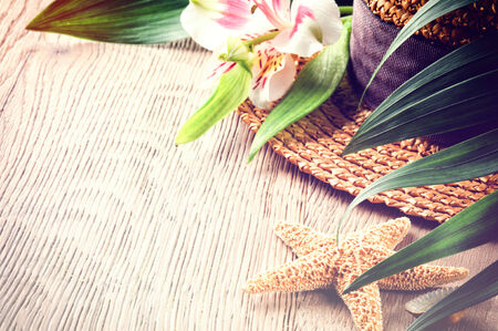Summer holiday background with straw hat and sea star photo