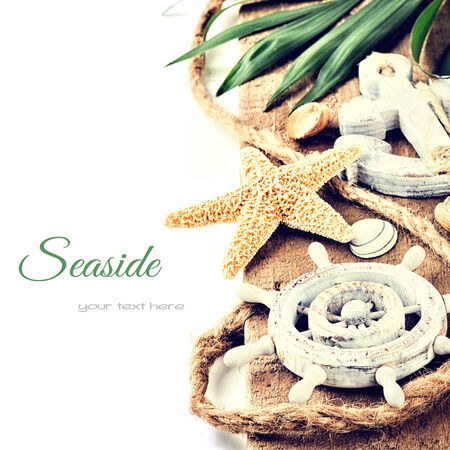 Summer holiday setting with seastar and ship wheel photo