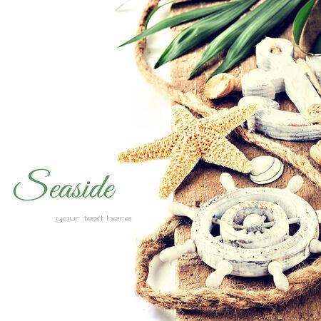 Summer holiday setting with seastar and ship wheel photo