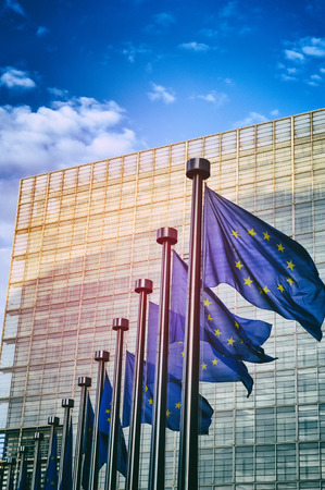 EU flags in front of European Commission in Brussels, Belgium Stock Photo