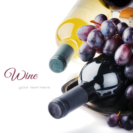 Bottles of red and white wine with fresh grape isolated over white photo