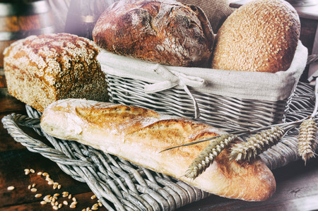 Various freshly baked bread in countryside setting photo