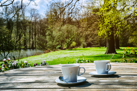 Two cups of coffee in outdoor setting Stock Photo