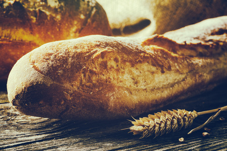french bread: Freshly baked traditional French bread on wooden table