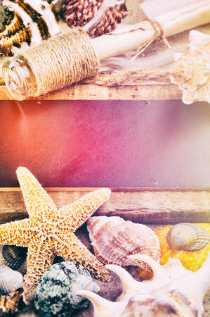 Summer holiday frame with sea shells and ancient bottle photo