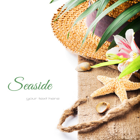 sea flowers: Summer holiday setting with straw hat and sea star