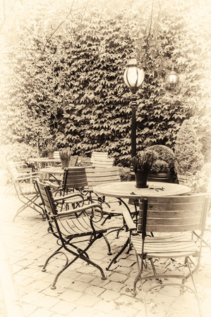 old fashioned sepia: Cozy cafe terrace in retro style. Bruges, Belgium