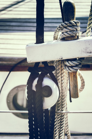Nautical ropes and pulleys on sailboat. Retro style photo