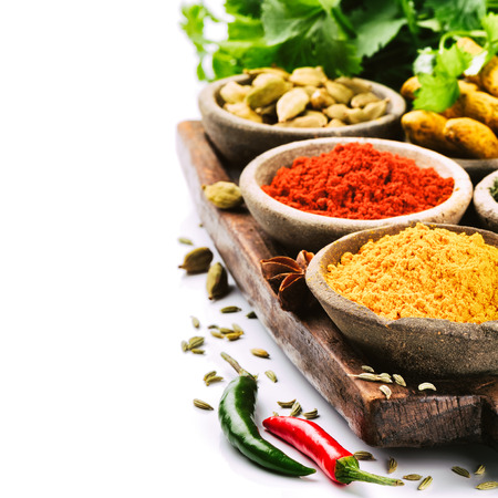 Colorful mix of spices isolated over white photo