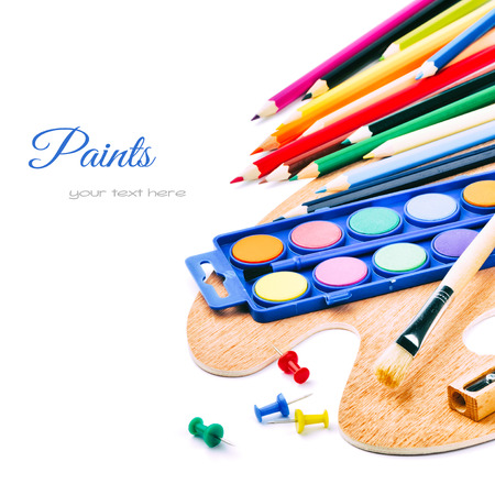 Colorful paints and crayons isolated on white background