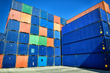 cargo container: Stacked cargo containers in sea port