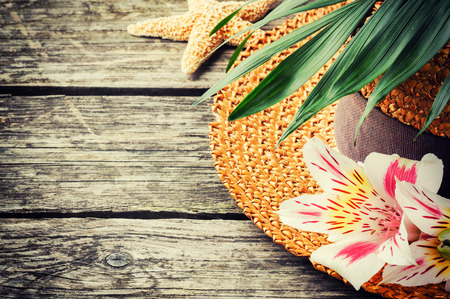 Summer holiday background with straw hat photo