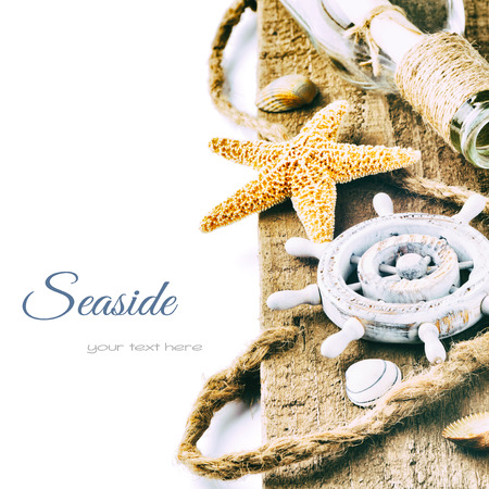 Summer holiday setting with starfish and shells photo