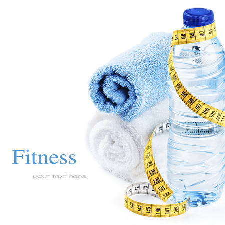 body toning: water bottle and towels isolated over white Stock Photo