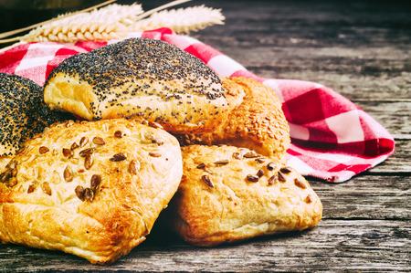 freshly: Freshly baked bread rolls in rustic setting Stock Photo