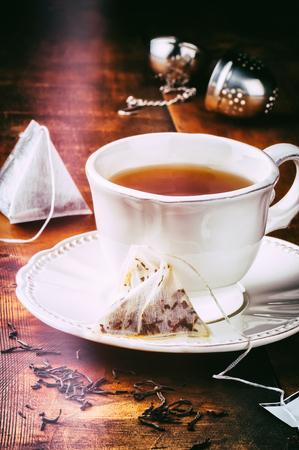 Tea time. Cup of hot black tea photo