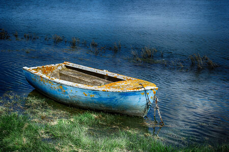 Old painted fishing boat at Normandy coast photo