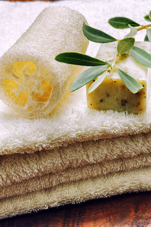 Rustic setting with natural olive soap and organic sponge photo