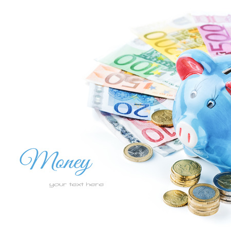 Piggy bank and various money isolated over white photo