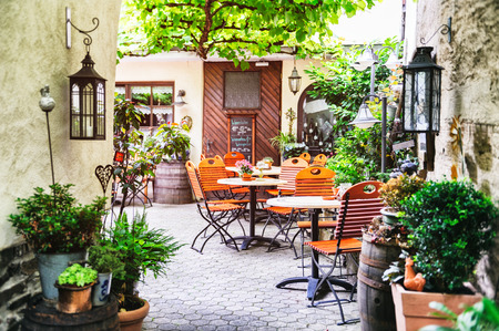 comfortable cozy: Cafe terrace in small European city Stock Photo