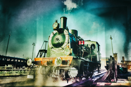 Historical steam engine train in motion photo