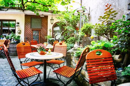 Cafe terrace in small European city at summer day photo