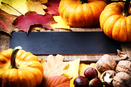 Autumn frame with pumpkins, walnuts and leaves Stock Photo
